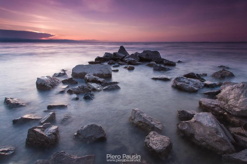 fotografo di paesaggio in laguna di grado